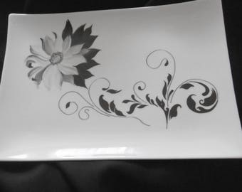 Hand painted porcelain rectangular dish. Modern decor with a grey flower and its black shadow with arabesques