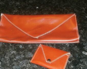 worn clutch hand bag