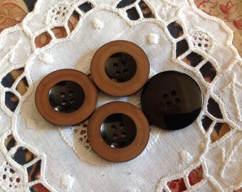 Set of four vintage buttons, round, Brown