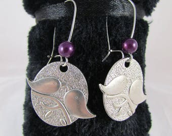 Birds and mauve magic beads medal earrings