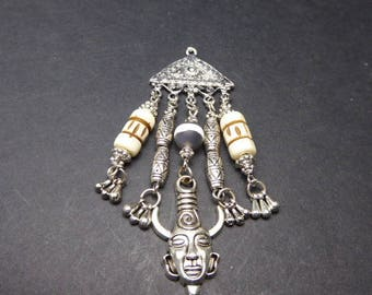 Totem charm and carved Horn beads