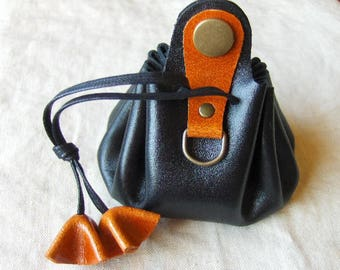 Coin purse is leather black rust-handmade