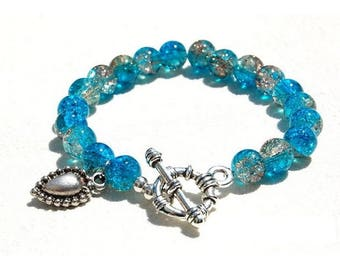 Glass and sterling silver charm, blue and champagne jewelry bracelet