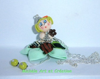 Miss Choupette in green and Brown polymer clay