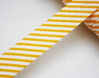 Bias striped yellow/orange and white 18 mm, folded, striped