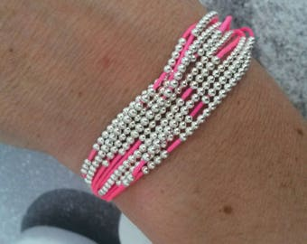 Neon pink multi-row bracelet and beads