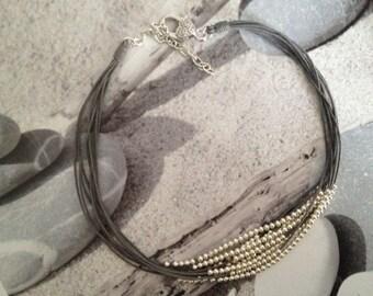Necklace multi strand multi gray pearls