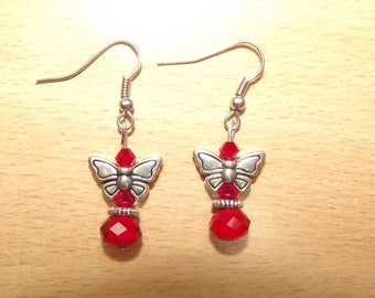 Red earrings with butterfly charms.