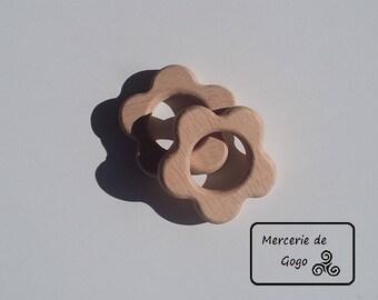 Natural wooden teething ring. Flower shape.