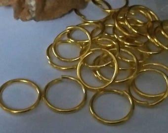 set of 20 large gold metal rings