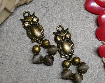 Set of charms in bronze and glass beads