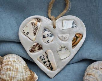 Sea tumbled pottery heart - black & white