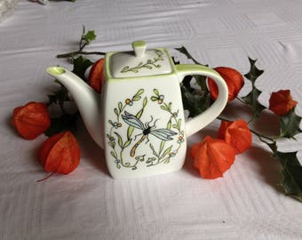 A single hand decorated fine bone China teapot.