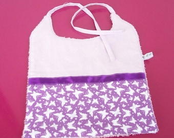 child's bib in cotton fabric and purple towel with butterflies