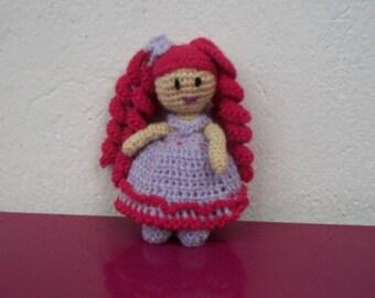 Mini hooked wool doll