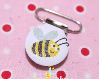 Strap clip pacifier patterned yellow bee on a 25mm round shape white background