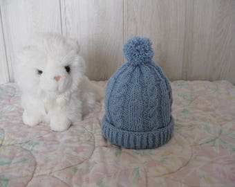 twisted blue knit hat