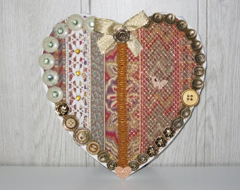 heart on canvas, fabrics and lace buttons