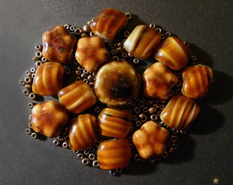 17 ceramic, glass paste and 130 small Golden glass beads