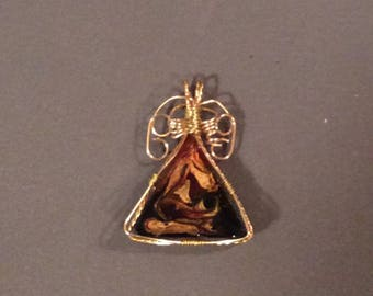 Brass and resin pendant