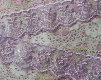Purple lace scalloped on 2 sides and intricately embroidered flowers polyester 4,00 cm width