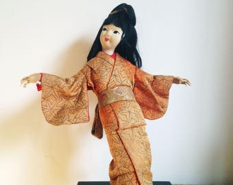 1950's Japanese Geisha Doll on stand in silk kimono