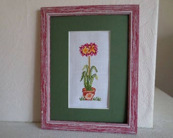 frame with mat and cross stitch