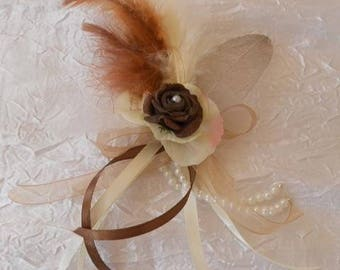 back train, brooch or boutonniere ivory and chocolate
