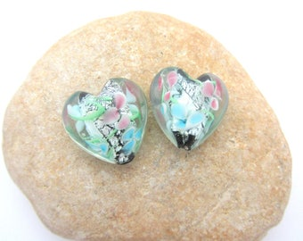 Set of two green glass hearts