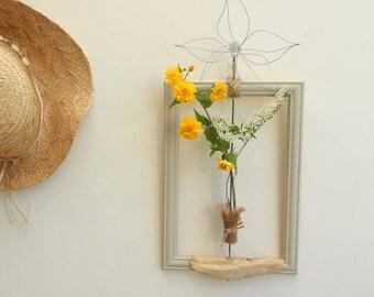 Original vase on frame and drift wood