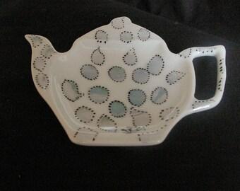 Bag Dimensions porcelain Teacup rests: 11 * 9 cm