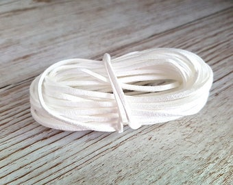 1 meter of white suedine cord