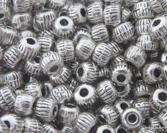 Set of 16 beads streaked in 3 mm Tibetan silver