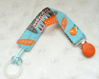Pacifier pacifier/reversible fabric, feathers and ethnic motifs