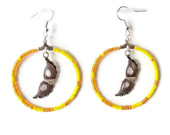 Carnival mask earrings yellow and orange seed beads