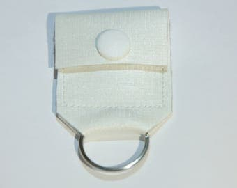 Chip holder and the white button cream-colored leather keychain