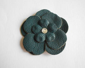 large faux leather blue and clear rhinestone flower