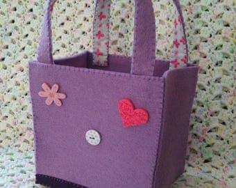 Small purple felt bag.