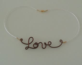 """Love"" necklace hand made chocolate coloured aluminum."