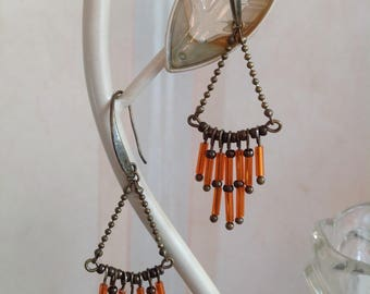 Bronze and orange triangular earrings.