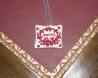 Miniature pillow embroidered on silk gauze