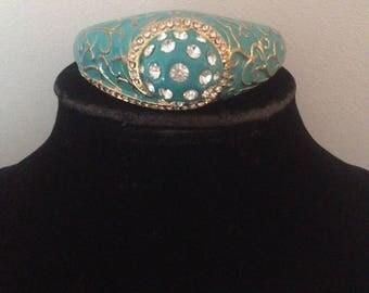 Green with gold tone rhinestone bracelet