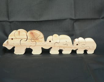 Puzzle 3 elephants in woodcut
