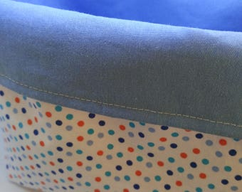 Empty basket blue pocket and multicolored polka dots