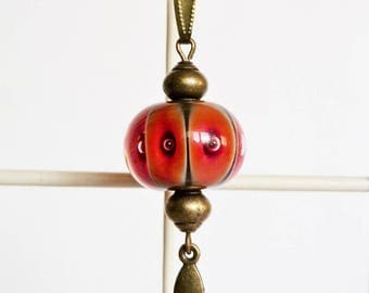 Long necklace with orange and black Lampwork Glass Bead, bronze metal