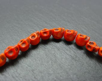 Orange set of 30 beads skulls