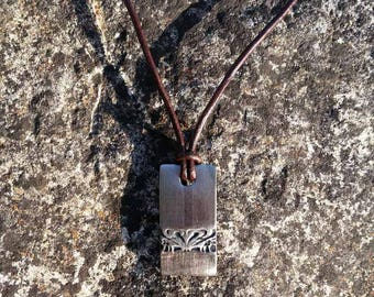 Leather and steel necklace