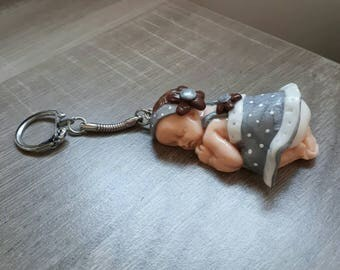 Baby girl with polymer clay keychain