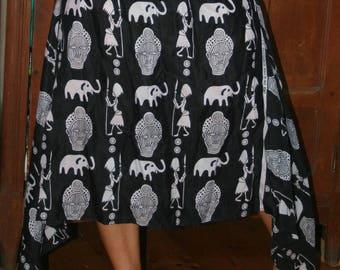 a unique skirt asymmetric long mid
