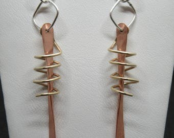 Beautifully designed silver, copper, and brass earrings